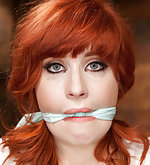 Redhead roped, suspended, clasped, dildoed