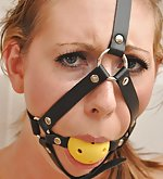 Slut slave handcuffed and harness ball-gagged
