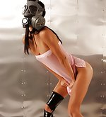 Skinny girl wearing a civilian gas mask